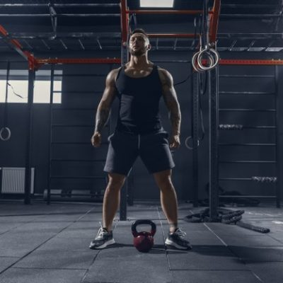 unstoppable-young-muscular-caucasian-athlete-practicing-squats-gym-with-weight-male-model-doing-strength-exercises-training-lower-body-wellness-healthy-lifestyle-bodybuilding-concept_155003-28004